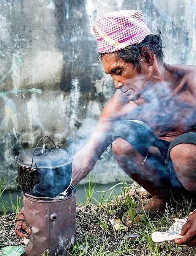 homeless man cooking